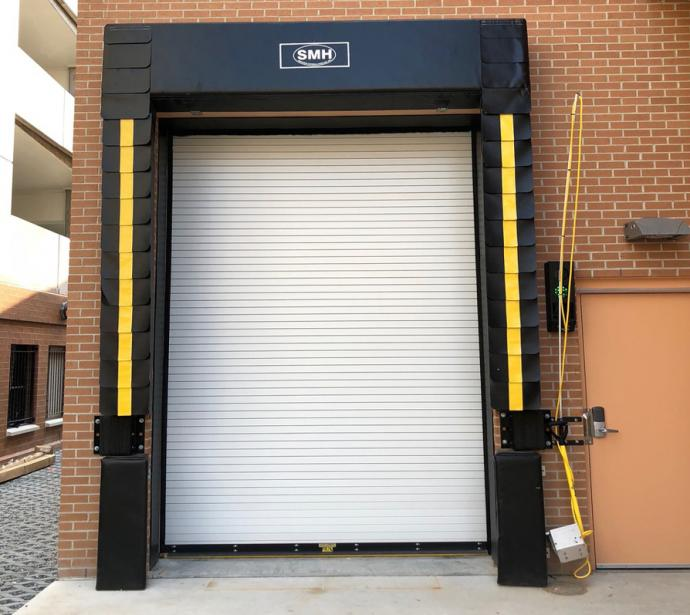 Exterior Rolling Steel Fire Door with a custom Dock Seal and Wheel Chock Security Interlock